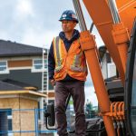 Worker on Excavator
